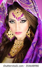 Portrait of a beautiful female model in traditional indian bridal costume and jewellery and makeup