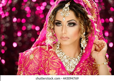 Portrait of a beautiful female model in traditional ethnic costume with heavy jewellery and makeup