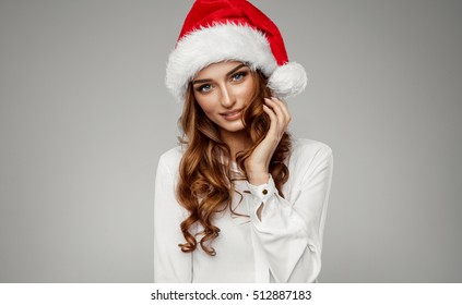 Portrait of beautiful female model wear santa hat