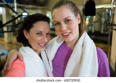 Portrait of beautiful fit women in gym