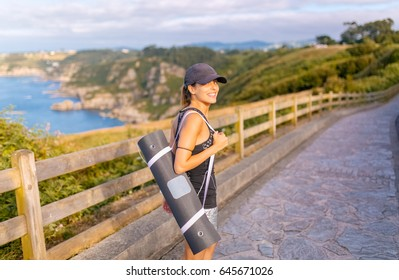 Portrait of a beautiful fitness woman outdoors
