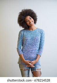 portrait of a beautiful friendly African American woman with a curly afro hairstyle and lovely smile isolated on a white background