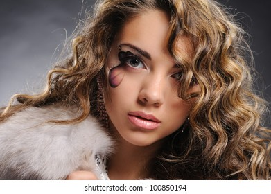 Portrait of beautiful gir with artistic make-up