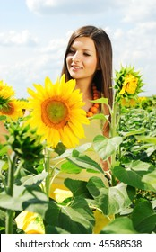 Portrait of beautiful girl among the sunflowers