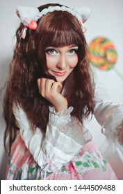 portrait of a beautiful girl with asian makeup. loli anime. girl in a beautiful dress in the style of kawai