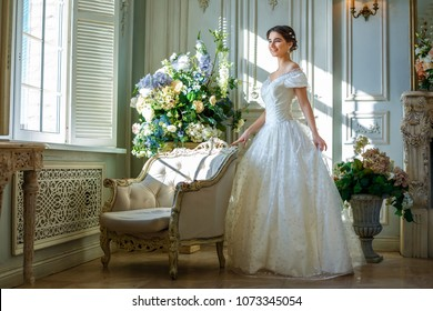 portrait of a beautiful girl in a ball gown in the interior. Concept of tenderness and pure beauty in sweet princess look. Beautiful girl in dress at romantic interior, fairytale in modern life