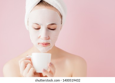 Portrait of beautiful girl in bathrobe with a cup of tea, relaxation concept blonde woman wearing bathrobe and towel on head after shower. Spa woman in bathrobe and turban.