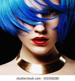 Portrait of beautiful girl with blue hair in the studio