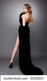 portrait of beautiful girl with bodyart of algae posing in long black dress