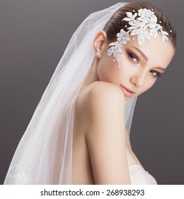 Portrait of beautiful girl bride in the studio on a black background, the concept of health and beauty