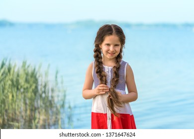 Portrait of a beautiful girl by the lake.