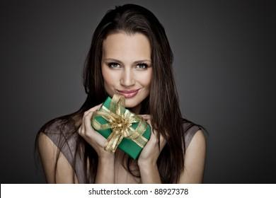 Portrait of beautiful girl with christmas gift