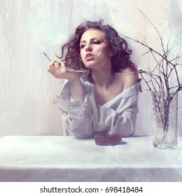 Portrait of a beautiful girl with a cigarette