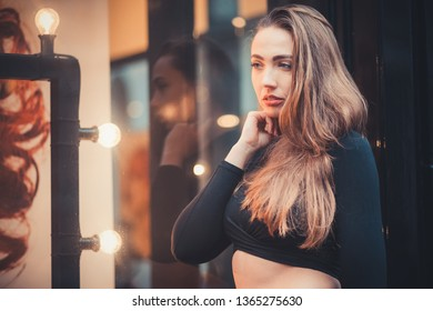 Portrait of a beautiful girl in the city
