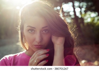 portrait of beautiful girl close-up with sunlight