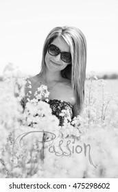 Portrait of a beautiful girl in the colza field black and white