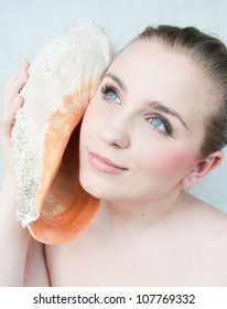 Portrait of a beautiful girl a conch shell