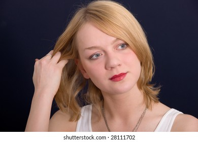 Portrait of the beautiful girl correcting a hairdress