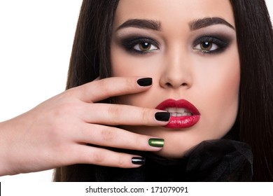 portrait of beautiful girl with dark hair, bright make up and dark nails