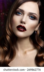 Portrait of beautiful girl with dark lips and blue eyes