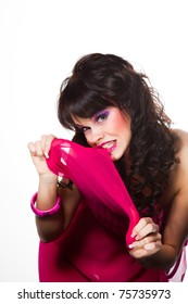 Portrait of beautiful girl with dark long curly hair and vibrant make-up wearing pink on white background