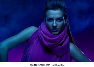Portrait of the beautiful girl in dark tones