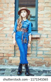 Portrait of a beautiful girl in denim suit in the style of a boho.