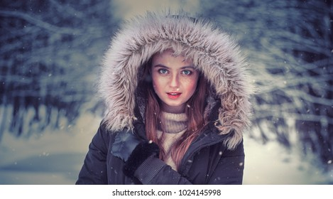 Portrait of a beautiful girl dressed for winter. Beautiful features, nice face