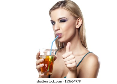 portrait of beautiful girl drinking her cocktail and showing thumbs up