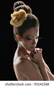 portrait of beautiful girl with elegant coiffure and art make up on black