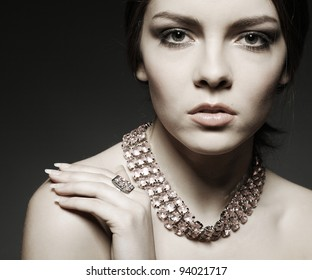 Portrait of beautiful  girl, emotions, cosmetics