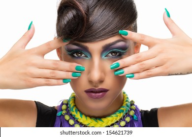 Portrait of beautiful girl with fancy hairstyle and bright makeup over white background