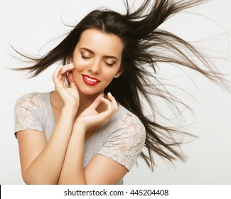 Portrait of a beautiful girl with fluttering hair