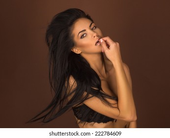 portrait of a beautiful girl with a flying hair on a background