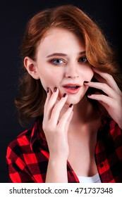 Portrait of beautiful girl. Freckled woman with wavy red hair and red lips