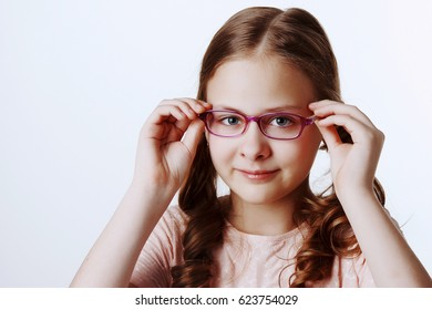 portrait of beautiful girl with glasses in the Studio