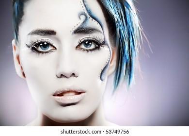 portrait of beautiful girl' half-face with mermaid body art