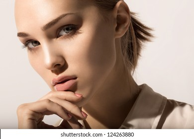 portrait of beautiful girl with hand near the face