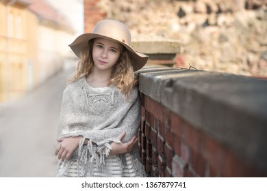 Portrait of a beautiful girl in a hat.