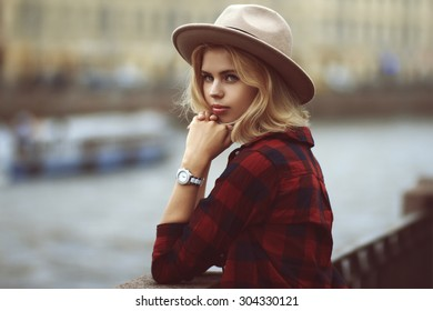 portrait of a beautiful girl in a hat