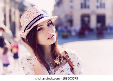 Portrait of beautiful girl in hat outdoors