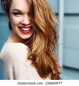 Portrait of a beautiful girl in a hat, smiling, lifestyle