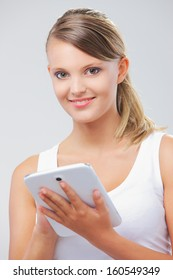 Portrait of beautiful girl with her digital tablet