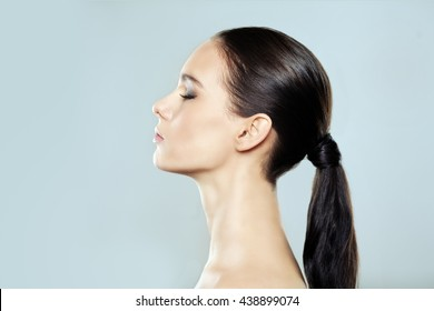 Portrait of a beautiful girl with her eyes closed