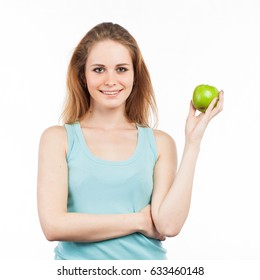 Portrait of a beautiful girl holding a green apple, isolated on white