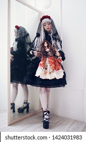 portrait of a beautiful girl in the image of the Japanese lolita. a girl in a black dress and silver hair is reflected in a mirror. anime style