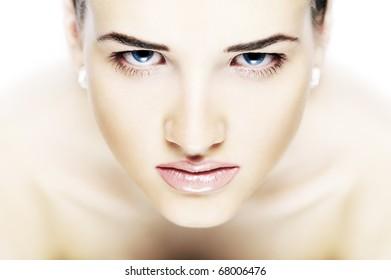Portrait of the beautiful girl in light tones
