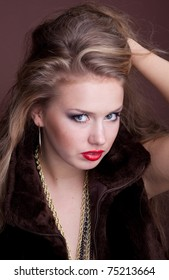 Portrait of a beautiful girl with long blond hair, closeup