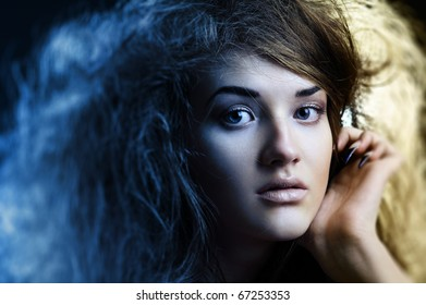 Portrait of the beautiful girl with a mad hairdress