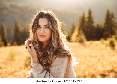 Portrait of a beautiful girl in the mountains in autumn